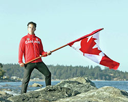 Nathan Hirayama holding flag. Credit: Kevin Light, Canadian Olympic Committee